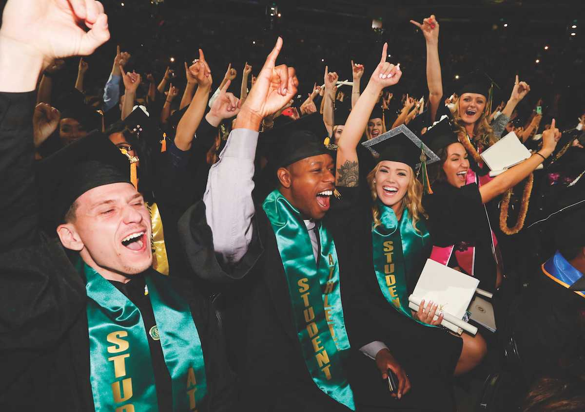 Graduates put their 'stingers up' during the spring 2016 commencement. The spring 2017 commencement was a source of controversy after issues with venue confirmation and available tickets. (Photo courtesy of Jessica Vernone / Sacramento State)