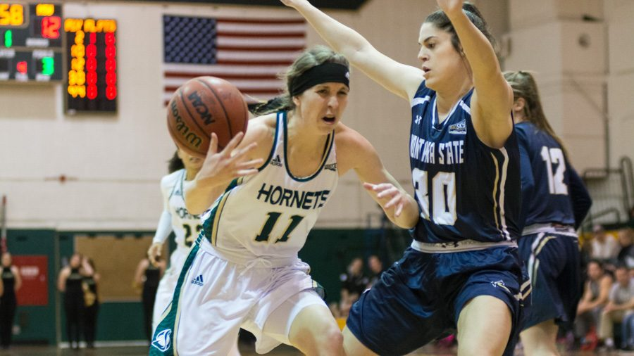 Sacramento State senior guard Emily Easom loses control of the ball after driving to the basket against Rebekah Hatchard of Montana State at the Nest on Feb. 18. (Photo by Matthew Dyer)