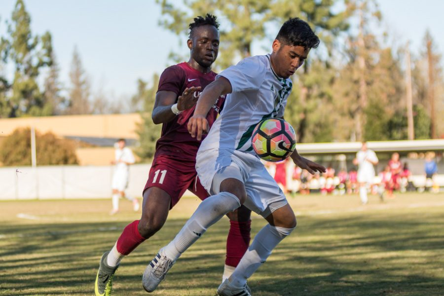Sacramento+State+freshman+defender+Abraham+Rosales+shields+the+ball+away+from+Gabe+Gissie+of+Sacramento+Republic+FC+during+an+exhibition+match+Wednesday+at+Hornet+Field.+%28Photo+by+Matthew+Dyer%29