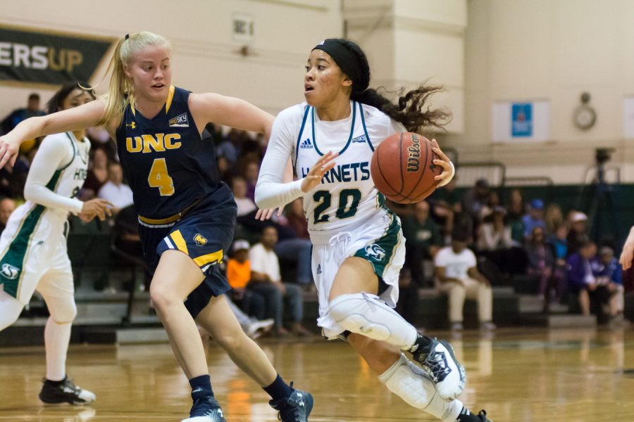 Sacramento State freshman guard Tiara Scott drives past Kristen Kramer of Northern Colorado at the Nest on March 3. (Photo by Matthew Dyer)