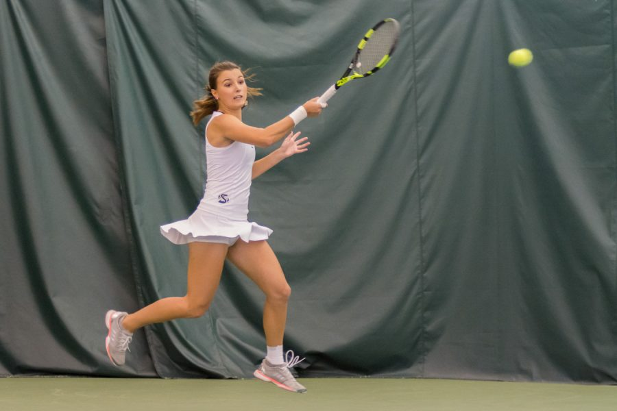 Sacramento State freshman Sofia Gulnova forehands the ball for a point against Montana Saturday at Spare Time Indoor Tennis Center. (Photo by Matthew Dyer)