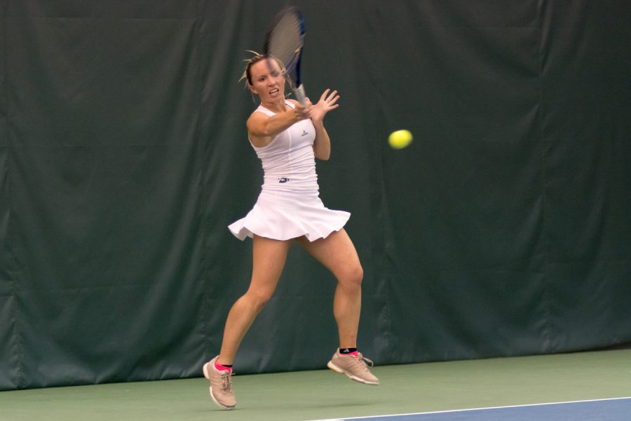 Sacramento State senior Andie Mouzes forehands the ball for a point against Montana Saturday at Spare Time Indoor Tennis Center. (Photo by Matthew Dyer)