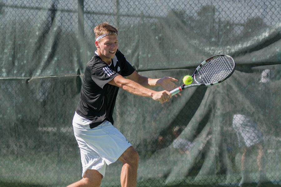 Sacramento+State+sophomore+Mikus+Losbergs+backhands+the+ball+during+a+singles+match+against+Grand+Canyon+in+the+Golden+State+Invite+Saturday+at+the+Sac+State+tennis+courts.+%28Photo+by+Matthew+Dyer%29