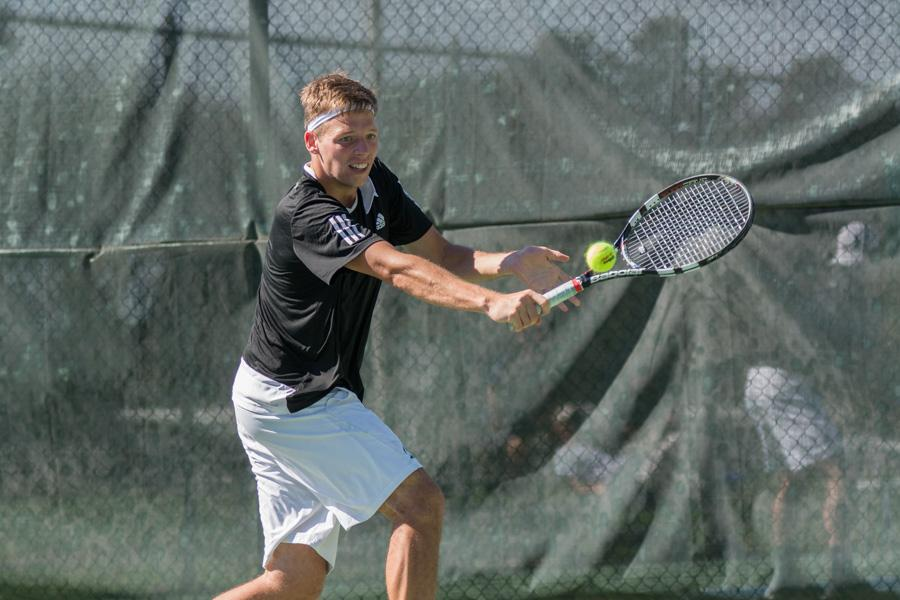 Sacramento State sophomore Mikus Losbergs backhands the ball during a singles match against Grand Canyon in the Golden State Invite Saturday at the Sac State tennis courts. (Photo by Matthew Dyer)