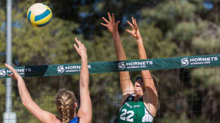 Sacramento State junior Lana Brown goes up for a block against Boise State at the Livermore Community Park on Sunday, March 12.
