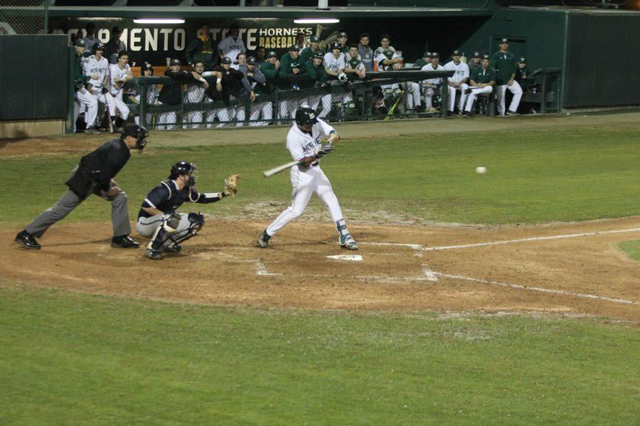 Sacramento+State+freshman+Ricky+Martinez+swings+before+making+contact+with+the+ball+against+Penn+State+Thursday+at+John+Smith+Field.+%28Photo+by+Myha+Sandeford%29