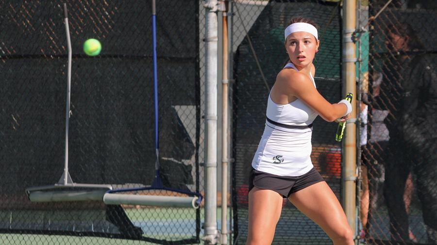 Sacramento State freshman Sofia Gulnova backhands the ball against Idaho State Saturday at the Campus Tennis Courts. (Photo by Cameron Leng)