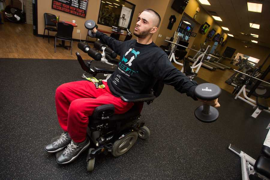 Sacramento State business major Devin Johnson works out during a recent visit to the gym. Johnson is launching FuseFit, an app dedicated to matching trainers with disabled clients. (Photo by Nicole Fowler)