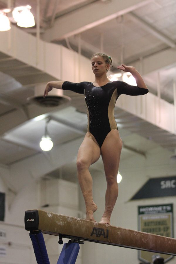 Sacramento State junior gymnast Jennifer Brenner performs her beam routine against UC Davis and Seattle Pacific Saturday at the Nest. (Photo by Myha Sanderford)