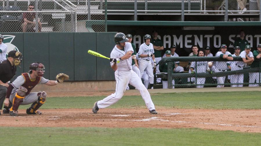 Sacramento State senior Trent Goodrich swings and makes contact with the ball against Minnesota Thursday at John Smith Field. (Photo by Rebecca Armbruster)
