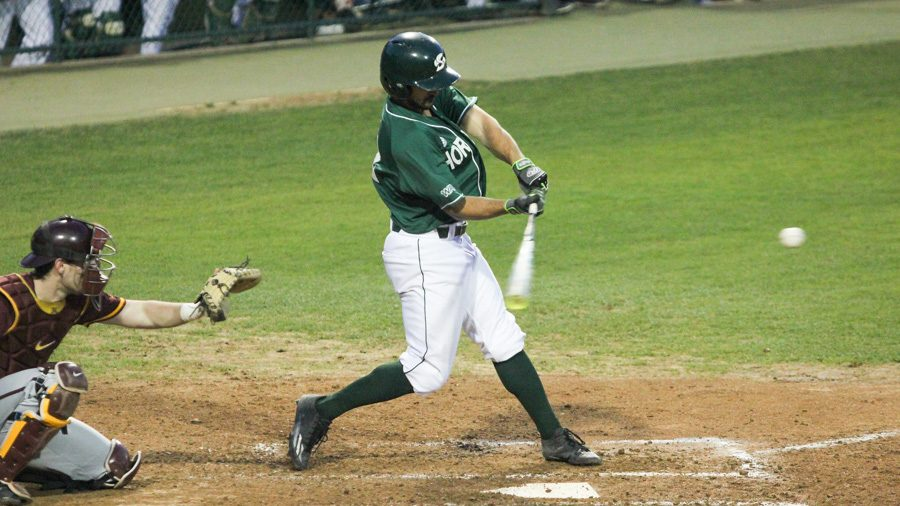 Sacramento State junior Vinny Esposito swings and makes contact with the ball against Minnesota Friday at John Smith Field. (Photo by Andre Newell)