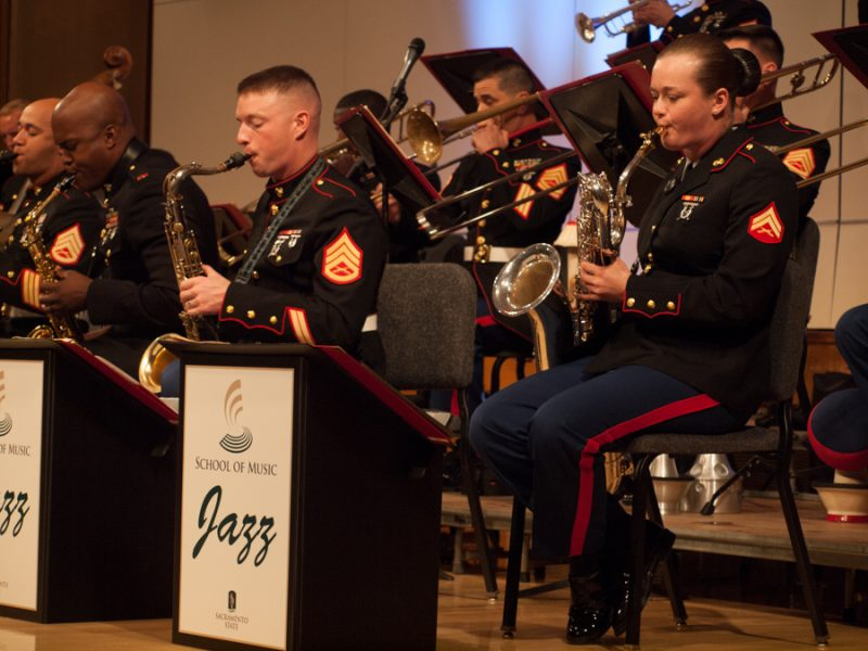 U.S.+Marine+Corps+Jazz+Band%27s+member+Cpl.+Madeline+Young+plays+the+baritone+saxophone+along+with+Gunnery+Sgt.+Jason+Knuckles+during+a+performance+at+Capistrano+Hall+on+March+9.+%28Photo+by+Andro+Palting%29