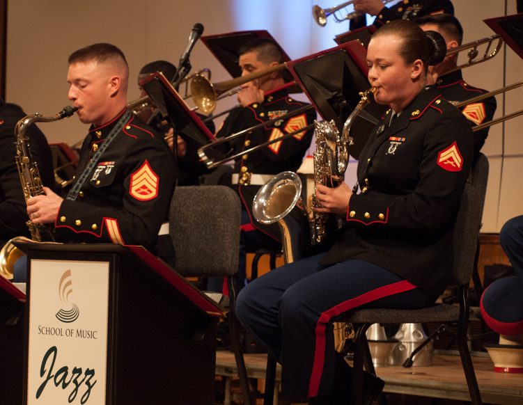 U.S. Marine Corps Jazz Band's member Cpl. Madeline Young plays the baritone saxophone along with Gunnery Sgt. Jason Knuckles during a performance at Capistrano Hall on March 9. (Photo by Andro Palting)