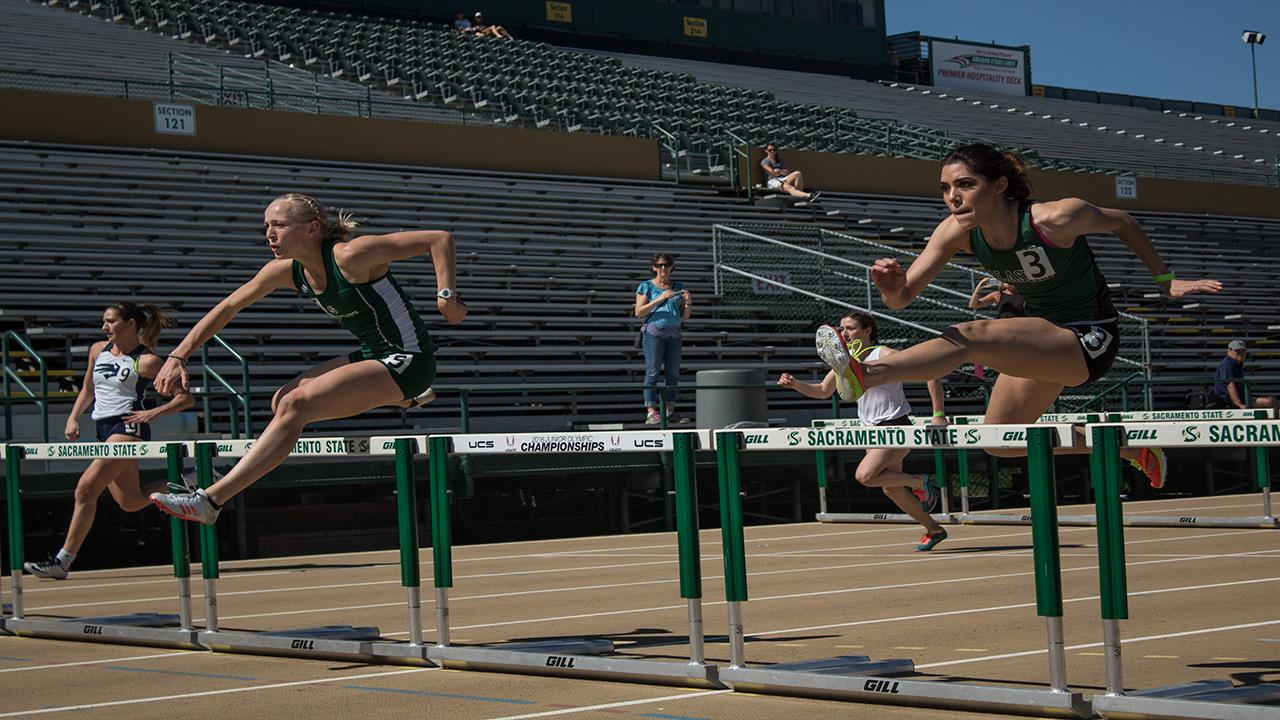Sacramento State senior Elizabeth Venzon, left, and sophomore Emilia Del Hoyo compete in the 100 meter hurdles as a part of the heptathlon in the Hornet Invitational Friday at Hornet Stadium. (Photo by Matthew Nobert)