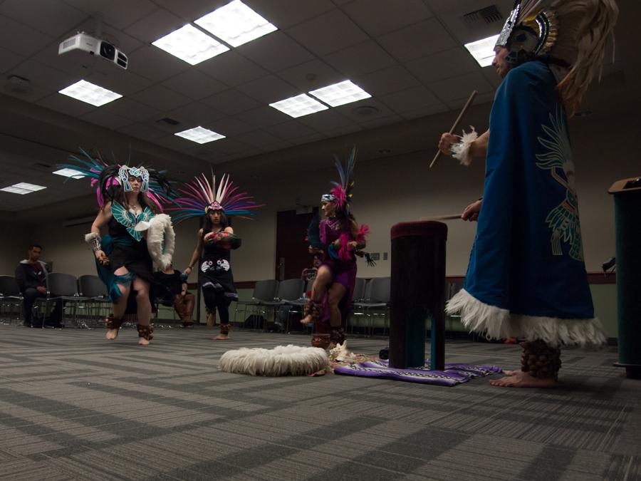 Native American dance group Ixtatutli/White Hawk performs in the Foothill Suite of the University Union on Tuesday. (Photo by Andro Palting)
