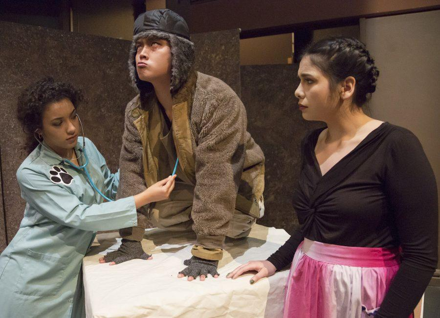 As Jason Fong slowly changes into a dog, he is checked out by veterinarian Monique Crawford, left, and wife McKenzie Lopez, in Stories to be Told, which runs at the Playwrights' Theatre in Shasta Hall from March 8 to 19. (Photo courtesy of Craig Koscho / Sacramento State)