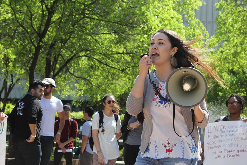 Laura Ramirez, a teaching credential student at Sacramento State, speaks through a megaphone at a protest in the library quad on Thursday, March 30 called 'A Culture of Love and Hope for All.' (Photo by John Ferrannini)
