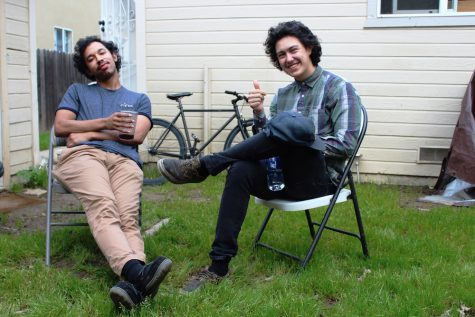 Derek Lynch, left, and Frank Lopes Jr., better known as Hobo Johnson and the Lovemakers, relax in the Oak Park backyard where they produce their music.  The group is set to return to Concerts in the Park after last year's performance in Cesar Chavez Plaza.