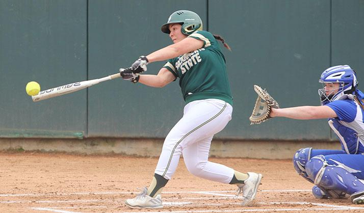 Sacramento State  makes contact with the ball against Seton Hall Tuesday at Shea Stadium. (Photo by Cassie Dickman)