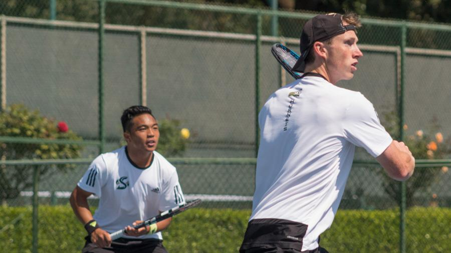 Sacramento State sophomore Dom Miller, right, and freshman Hermont Legaspi, left, get ready to return the ball during doubles play against Drexel Thursday at the Rio Del Oro Racquet Club. (Photo by Matthew Nobert)