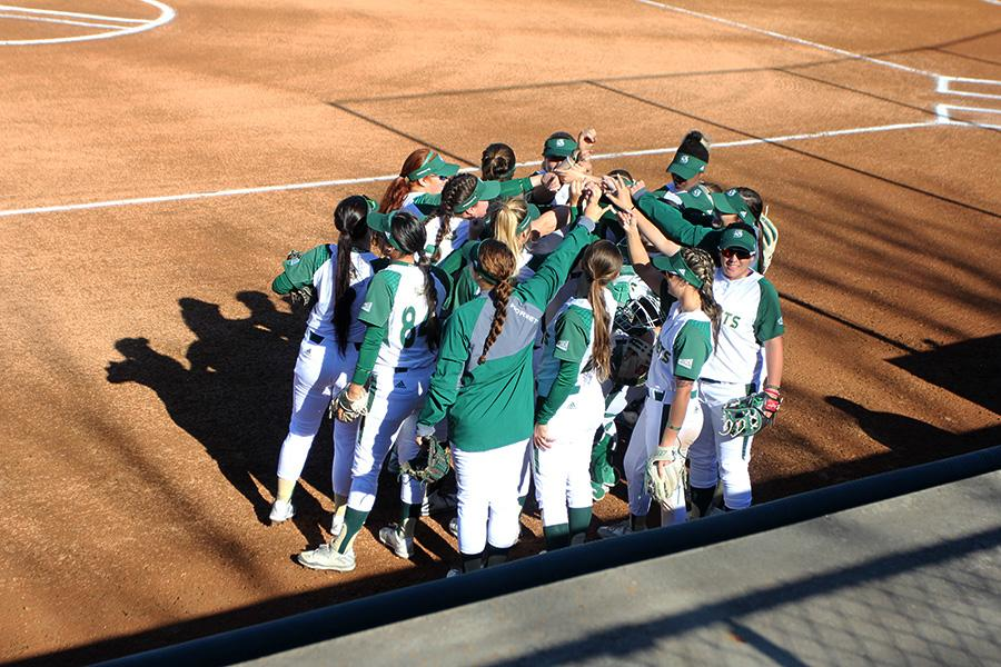 Sacramento State softball team huddles up before the second game of a doubleheader against Nevada Wednesday at Shea Stadium. (Photo by Raul Hernandez)