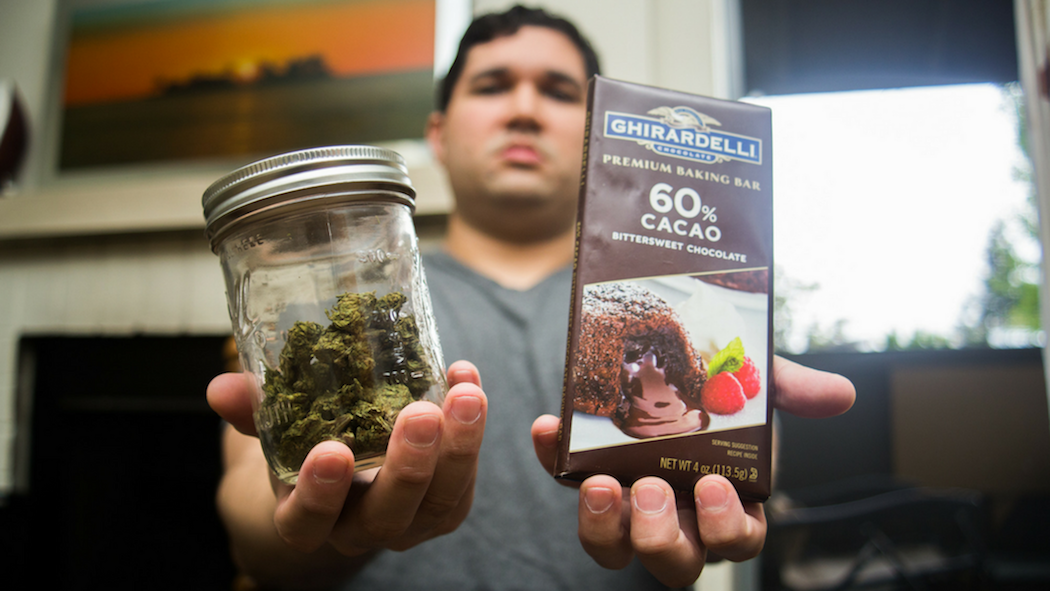 Sacramento State alumnus Vincent Martinez, 29, holds the tolls of his trade as a manufacturer of edible marijuana products. (Photo by Nicole Fowler)