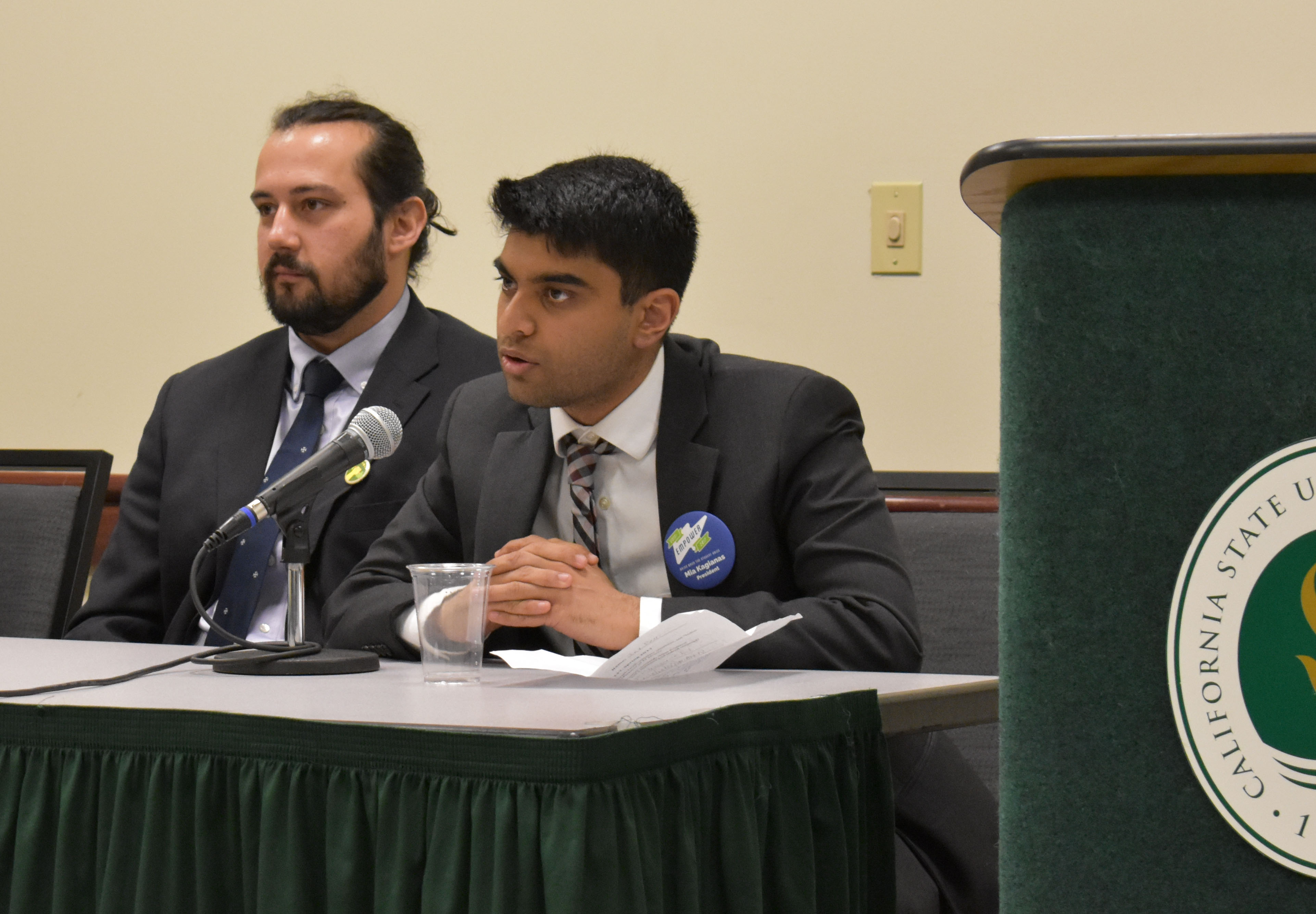 Director of Social Sciences and Interdisciplinary Studies candidates Danial McGhie, left, and Jay Passi, right, speak on campus at a Sacramento State ASI candidate forum on March 30 in the Forest Suite of the University Union. (Photo by Cassie Dickman)