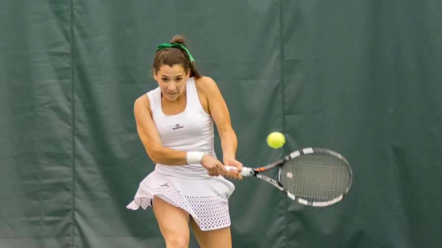 Sacramento State junior Ana Loaiza Esquivias backhands the ball during a singles match against Long Beach State Friday at the Spare Time Indoor Tennis Center. (Photo by Matthew Dyer)