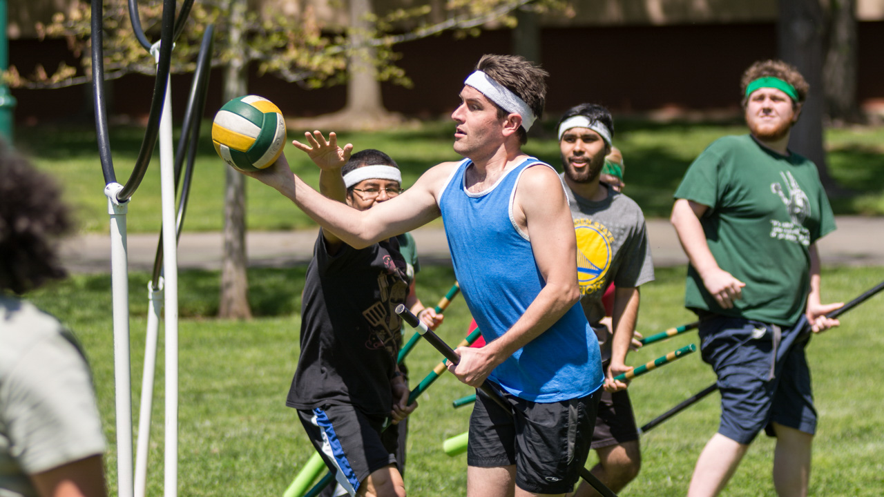 Sacramento State senior Tristan Church scores the quaffle past senior Josue Garcia during practice Friday on the South Green Lawn by The WELL. Each time the quaffle is scored through the rings, it is worth 10 points. (Photo by Matthew Dyer)