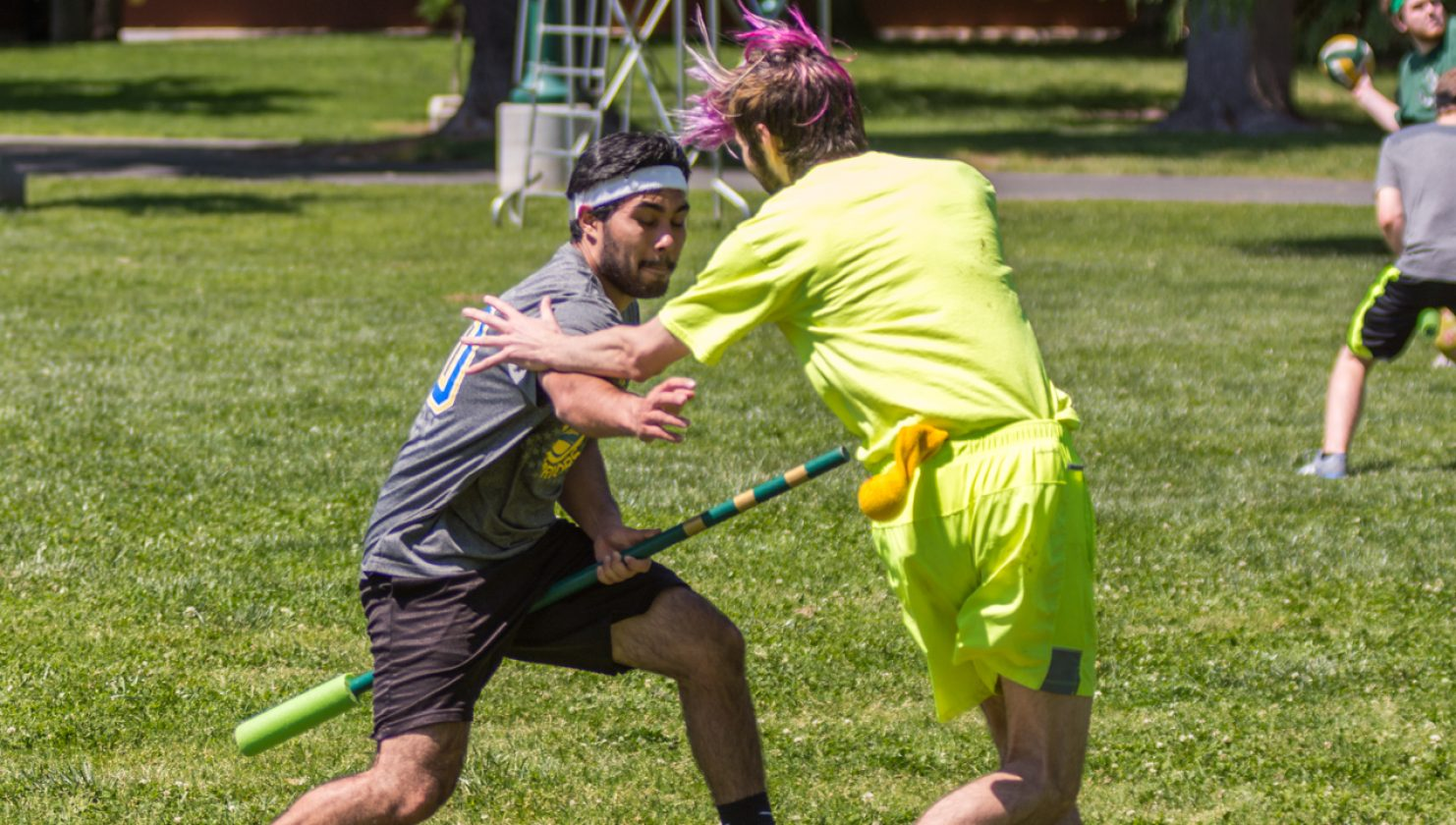 Junior history major Gabe Garcia tries to get the snitch from the snitch runner, Nate. During this practice, the club was short two members so they played with no seekers. (Photo by Matthew Dyer)