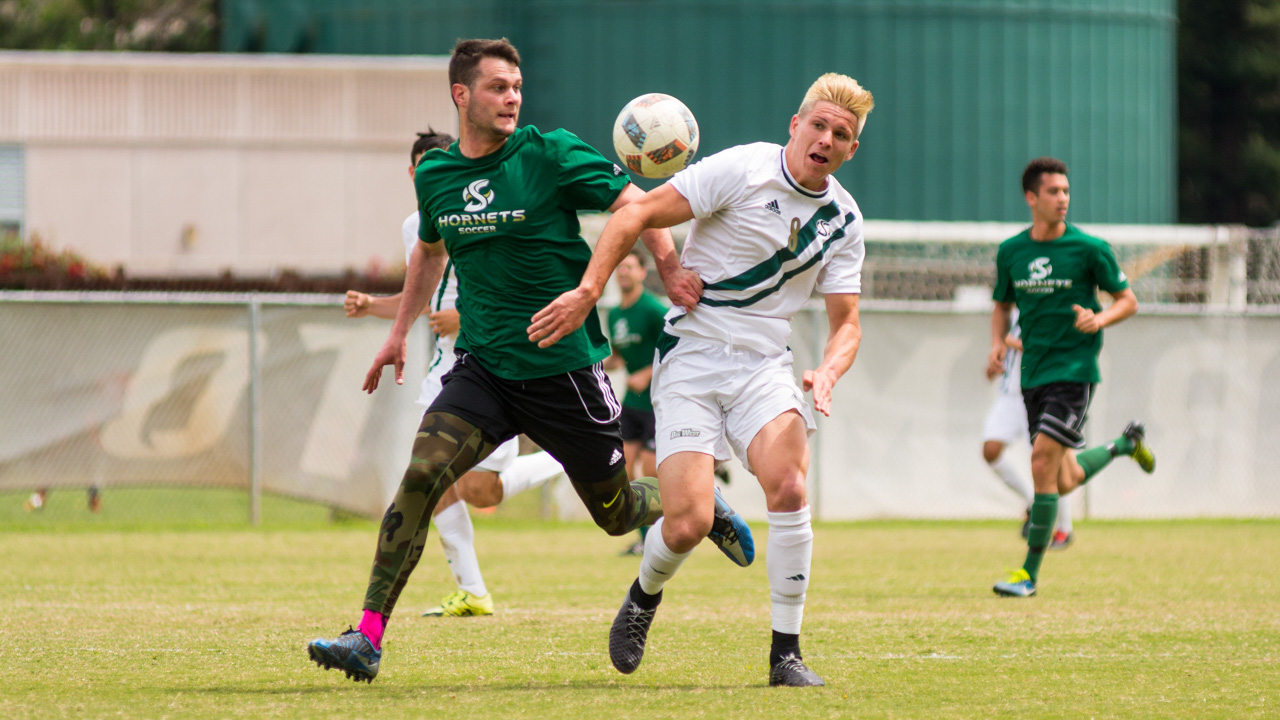 Sacramento State soccer commit and Cosumnes Oaks High School senior RJ Moorhouse battles for the ball at the Sac State alumni game Saturday at Hornet Field. (Photo by Matthew Dyer)