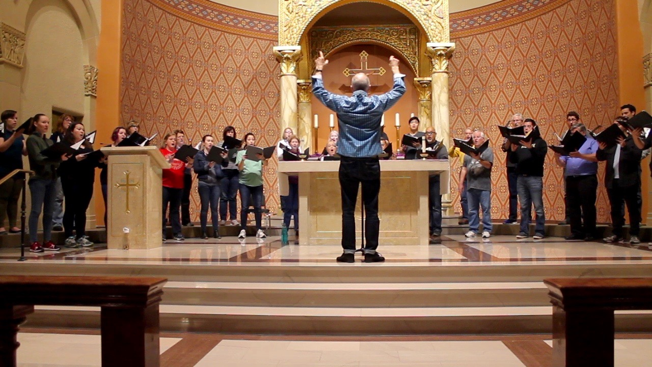 Sacramento State choral director Donald Kendrick leads the Sacred Heart Church group Schola Cantorum in a song during a rehearsal. The choir performs every Sunday at Sacred Heart's 11 a.m. mass. (Photo by Sami Soto)
