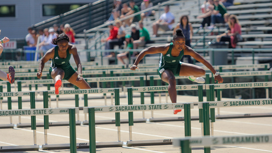 Sacramento State freshman Artearra Coffey, left, and senior Kristen Robinson, right, sprint in the women's 100-meter hurdle race in the Mondo Team Challenge April 1 at Hornet Stadium. (Photo by Andre Newell)