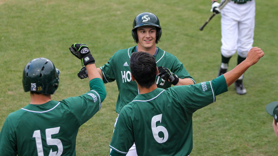 Sacramento State sophomore James Outman celebrates with his teammates after hitting a home run against UC Davis on April 11 at John Smith Field. (Photo by Max Jacobs)