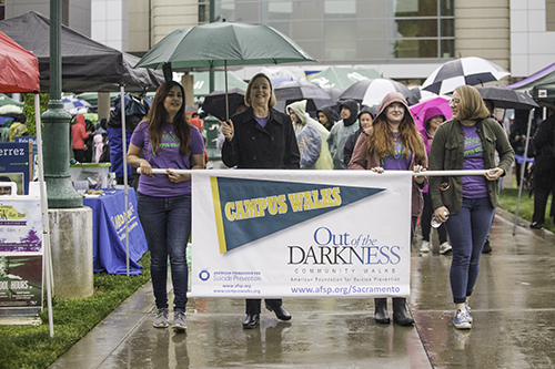 Jody Nelsen leads a crowd of supporters during the Out of the Darkness awareness event April 6, 2017. The walk is held annually to raise awareness about suicide prevention and mental health. (Photo by Nicole Fowler)
