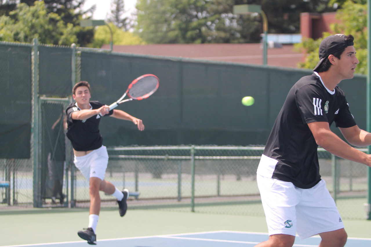 Sacramento State freshman Louis Chabut, left, returns the ball as sophomore Donald Hall, right, looks on during doubles play against Weber State Saturday at the Rio Del Oro Racquet Club. (Photo by Sami Soto)