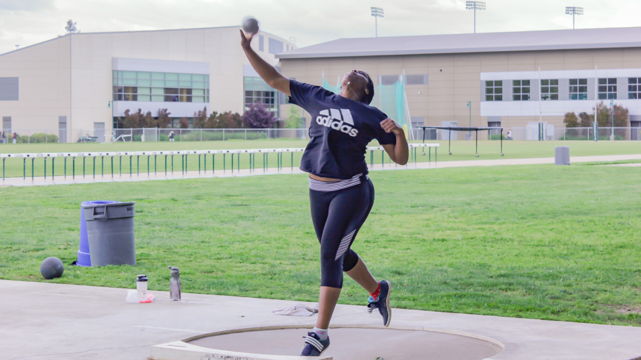 Sacramento State freshman thrower Morgan Jones practices her shot put during practice on April 12 at Hornet Stadium. Jones is one of four throwers who has helped Sac State become the 12th ranked team in the nation. (Photo by Andre Newell)