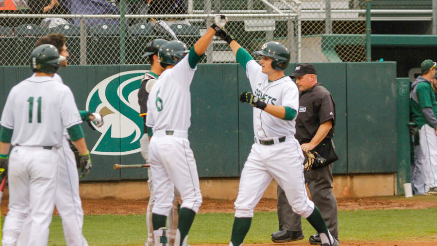 Sacramento State freshman Dawsen Bacho celebrates hitting a home run with freshman Ricky Martinez against San Francisco Monday at John Smith Field. (Photo by Max Jacobs)
