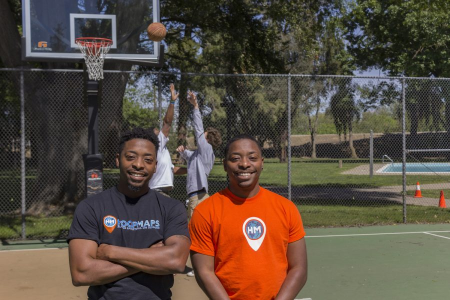Donte+Morris%2C+left%2C+and+Dominic+Morris%2C+right+pose+for+a+photo+as+members+of+the+HoopsMap+app+play+behind+them+at+Sacramento+States+reisdence+hall+baskeball+courts+on+April+3.+The+Morris+twins+created+the+HoopsMap+app+and+have+been+featured+on+ESPN+and+TechCrucnh+for+their+app.+%28Photo+By%3A+Matthew+Nobert%29
