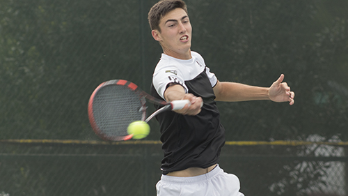 Sacramento State men's tennis player freshman Louis Chabot reaches to return the ball during singles play against the University of Hawaii on April 5 at Rio Del Oro Racquet Club in Sacramento Califronia. Sac State defeated Hawaii 7-0 moving them to (10-10 and 6-2 in the Big Sky). (Photo By: Matthew Nobert)