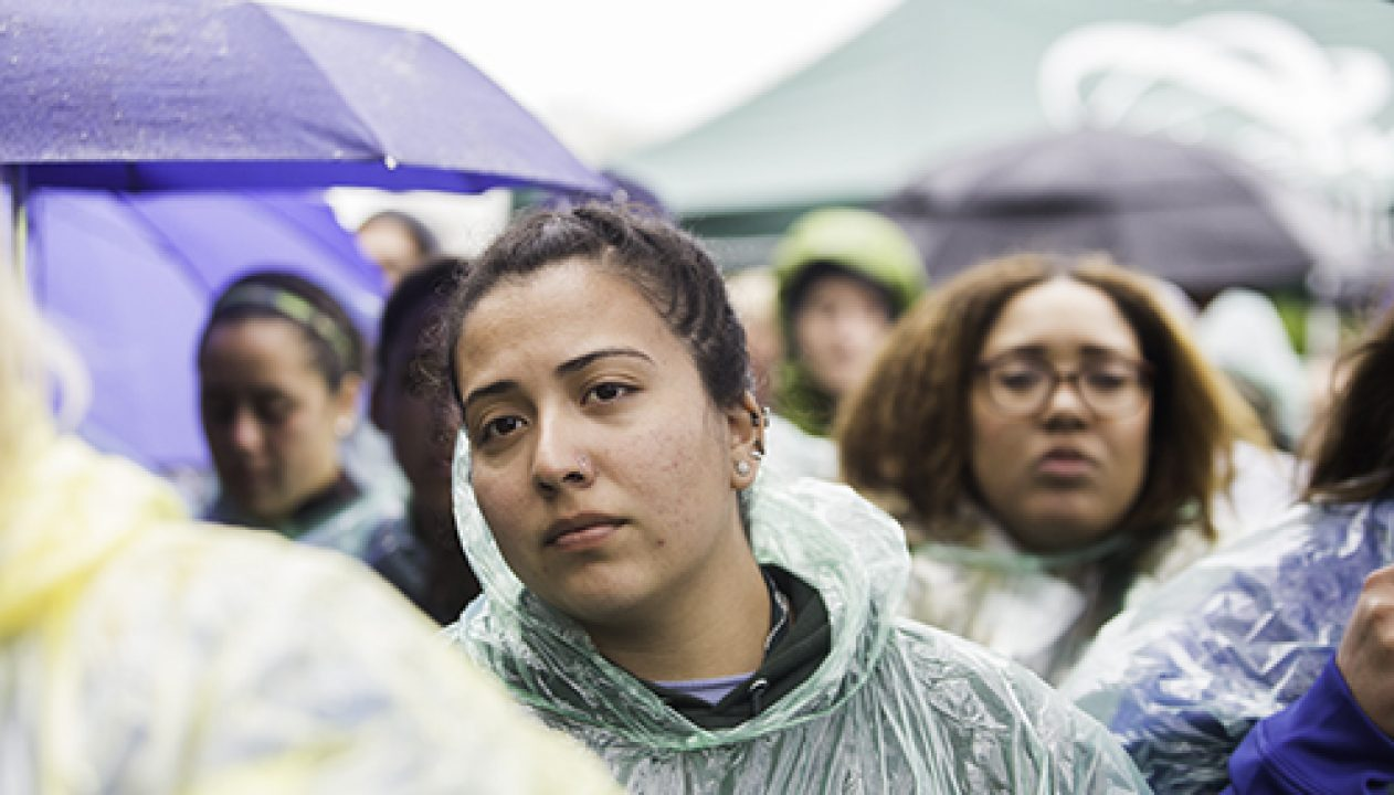 Crowd members listen to speakers in light rain at the Out of the Darkness awareness walk April 6, 2017 hosted by Sacramento State. The community walk is organized annual to bring awareness to mental health and suicide prevention. (Photo by Nicole Fowler)