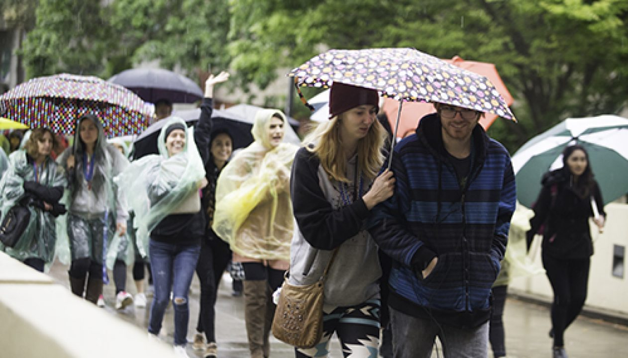 Despite wet weather, Sac State students and other community members walked through campus during the Out of the Darkness walk on April 6, 2017. The event was held to raise awareness of mental illness and suicide prevention. (Photo by Nicole Fowler)