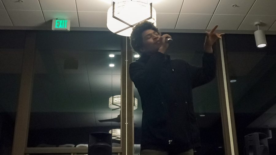 Sacramento State sophomore Kailord Low performs a poem at KSSU-AM's Poetry Slam night in the Residence Halls Dining Commons on April 7. (Photo by Myha Sanderford)
