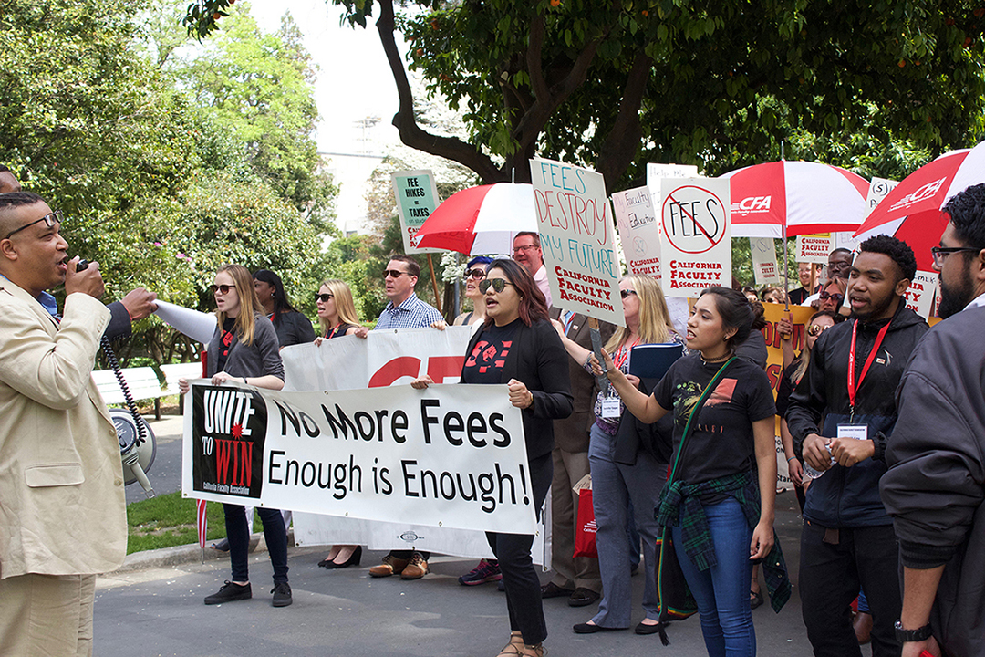 Members of the California Faculty Association and California State University students march on Wednesday from the Old Rose Garden in downtown Sacramento to the State Capitol. The protest intended to advocate for increased funding of higher education. (Photo by Carlo Marzan)