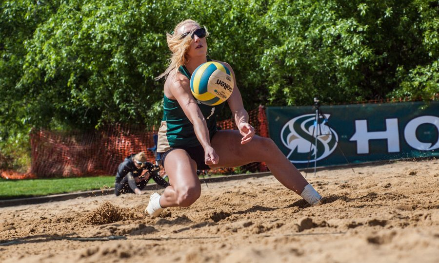 Sacramento State junior Kennedy Kurtz digs for the ball against San Francisco Saturday at Livermore Community Park in Folsom. (Photo by Andro Palting)
