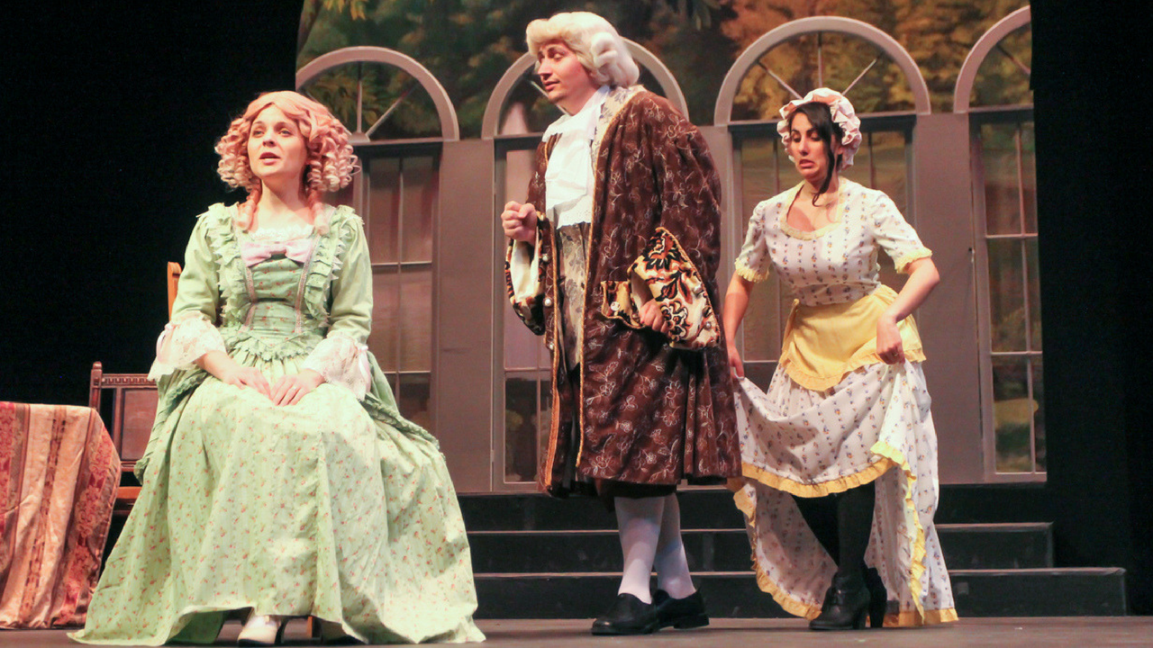 Justin Ramm-Damron, left, Gia Battista, center, and Tatiana Grabcuic, right, act out a scene in 'Tartuffe.' The opera will be performed in the University Theatre in Shasta Hall starting May 5 at 8 p.m. (Photo by Andre Newell)