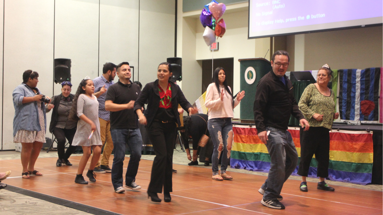 Attendees and staff members of the PRIDE Center dance and celebrate the center's 10th anniversary in the University Union Ballroom on April 28. (Photo by Khanlin Rodgers)