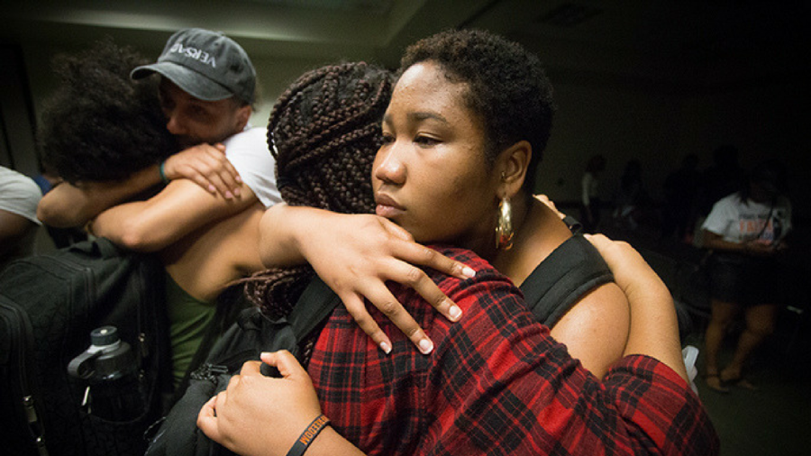 Students embrace each other during a memorial service held for Isaiah Alexander on May 3 in the University Union Orchard Suite. (Photo by Nicole Fowler)