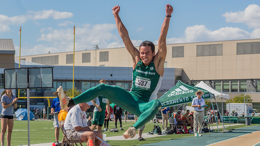 Sacramento State senior Michael Turner leaps in the air during the long jump event Friday in the Big Sky Conference Championships at Hornet Stadium. Turner won the long jump event with a leap of 25-08.00 to place him second in school history and ninth all-time in the Big Sky. (Photo by Matthew Nobert)