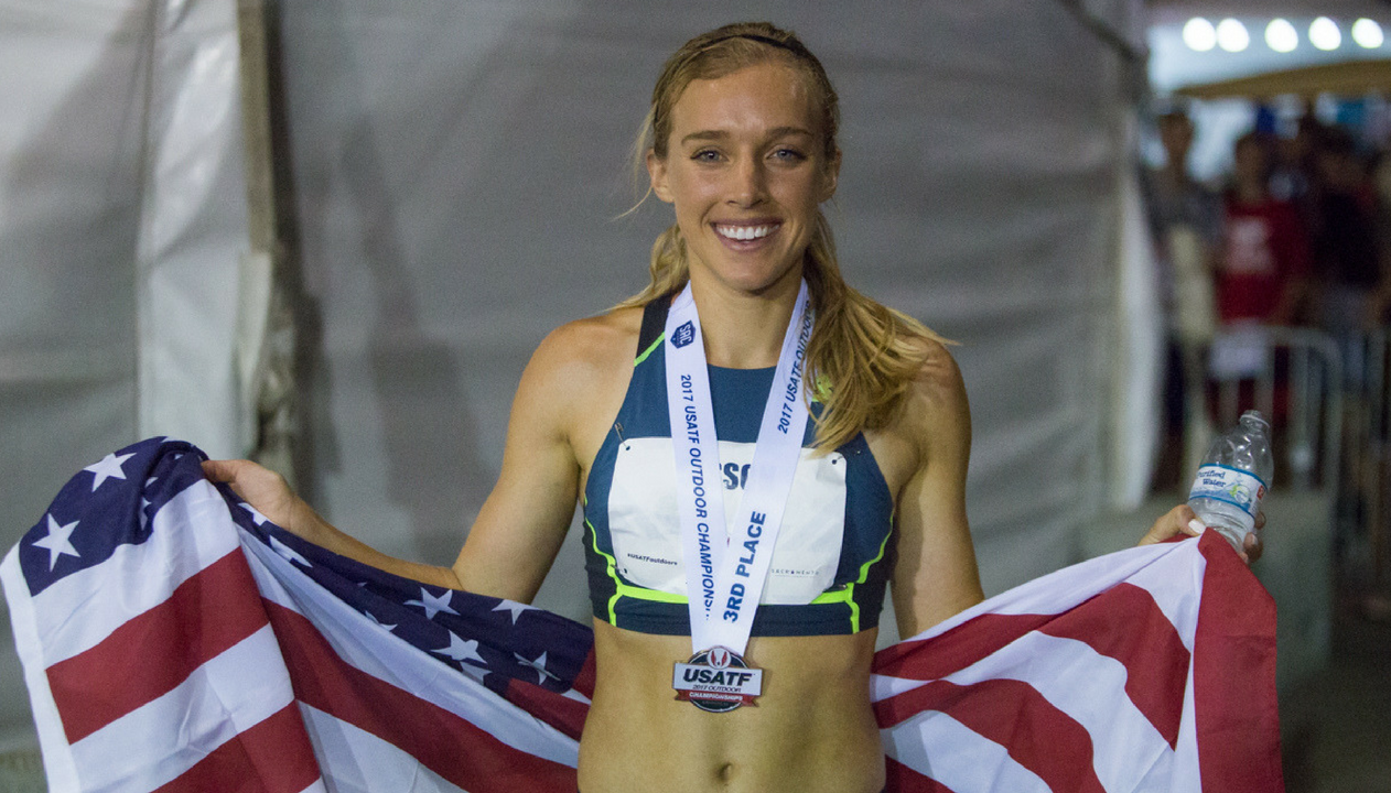 Third place finisher Emily Sisson proudly poses with the United States flag after competing in the women's 10,000-meter race Thursday at Sacramento State's Hornet Stadium. (Photo by Nicole Fowler)
